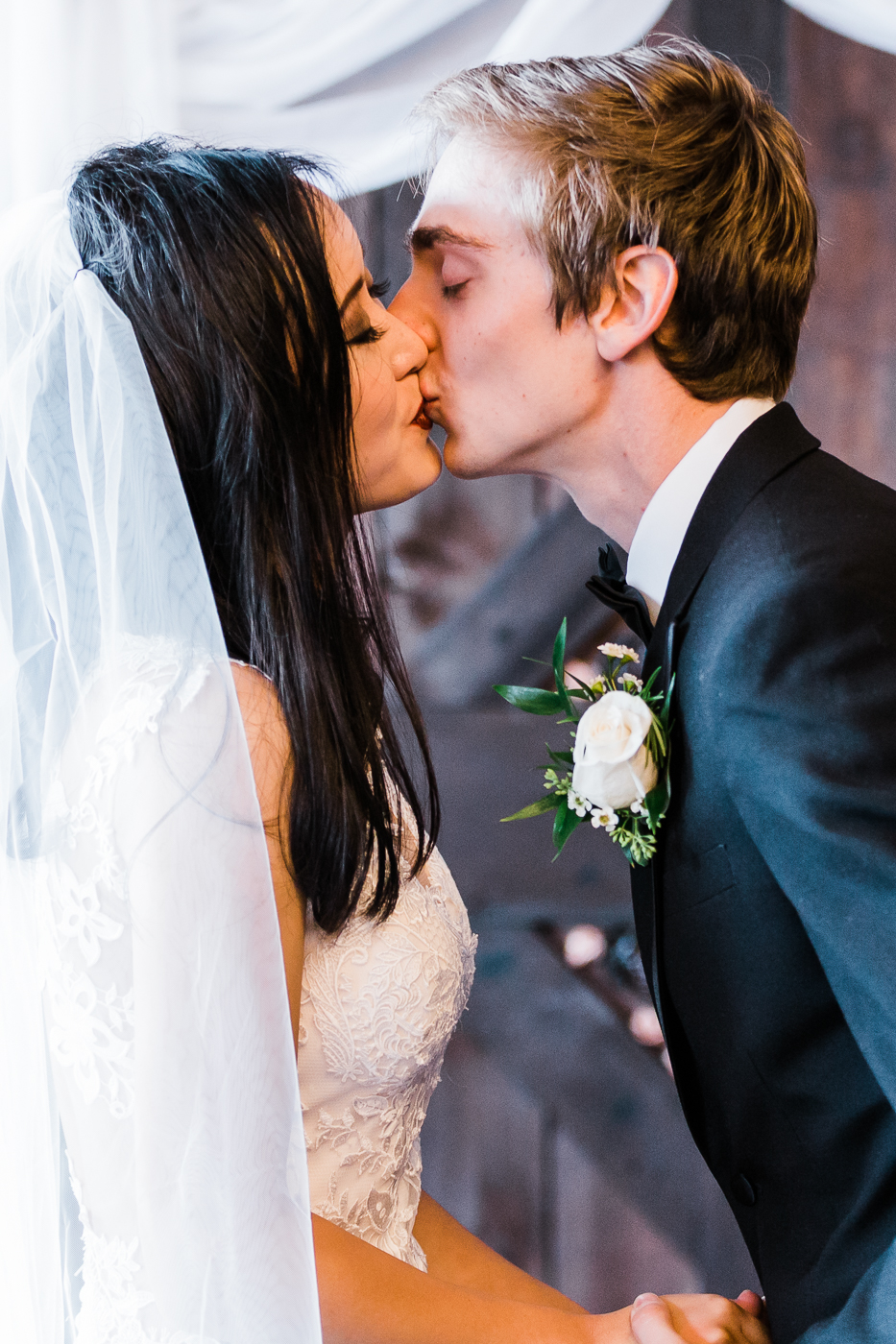 First kiss at intimate Abbotsford wedding.