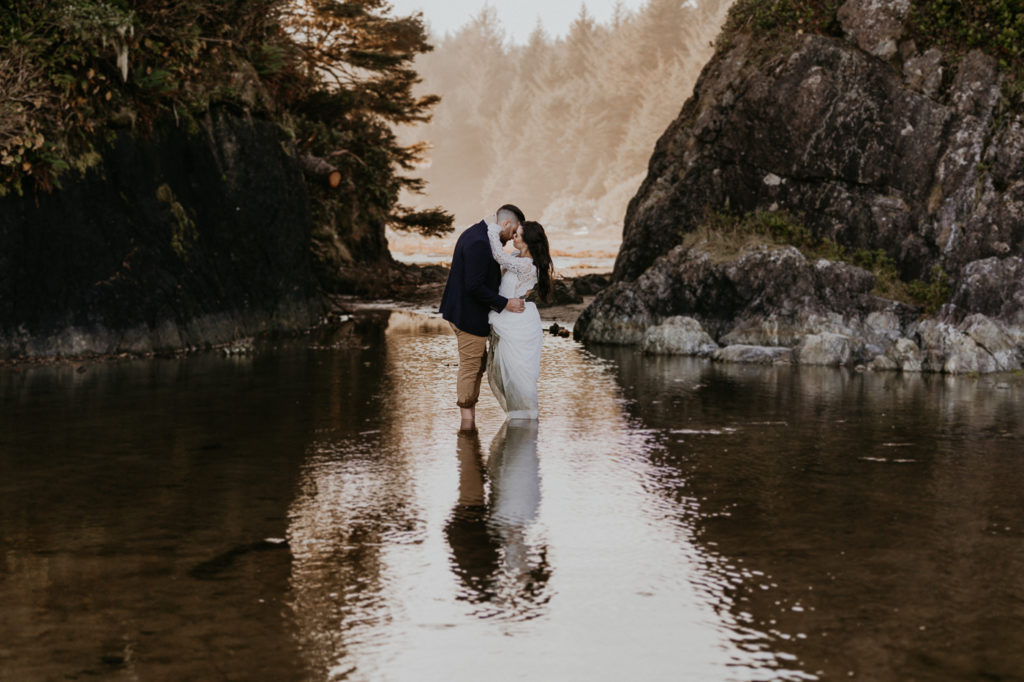 Eloping in Tofino.  Reflection kiss.
