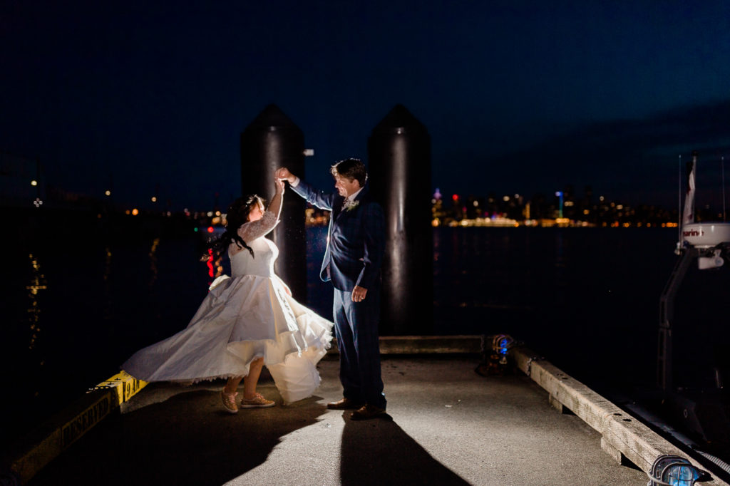 Choosing your wedding photographer, couple dancing on the pier.